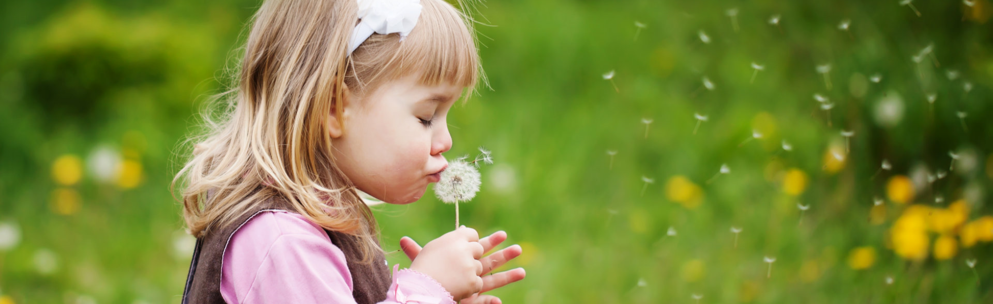 Girl kissing a flower